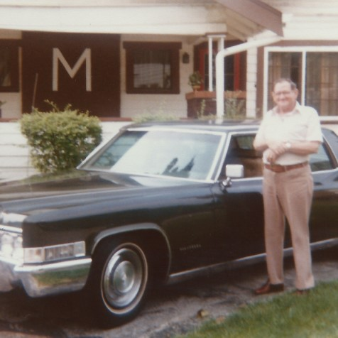 Dick Minshall with his Cadillac, 1983.